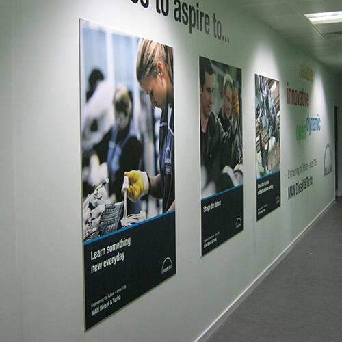 Large format printed posters hanging on the wall