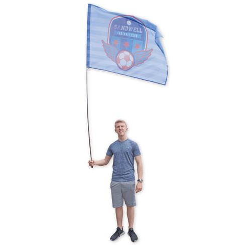 a man holding a Festival Flag