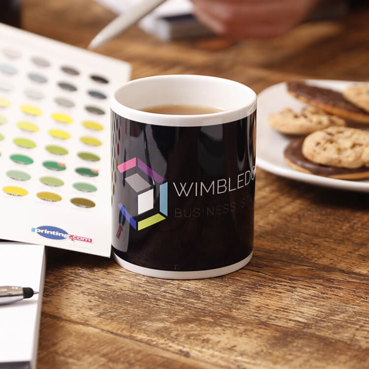 Wimbledon Business Studio Mug with coffee inside atop a table