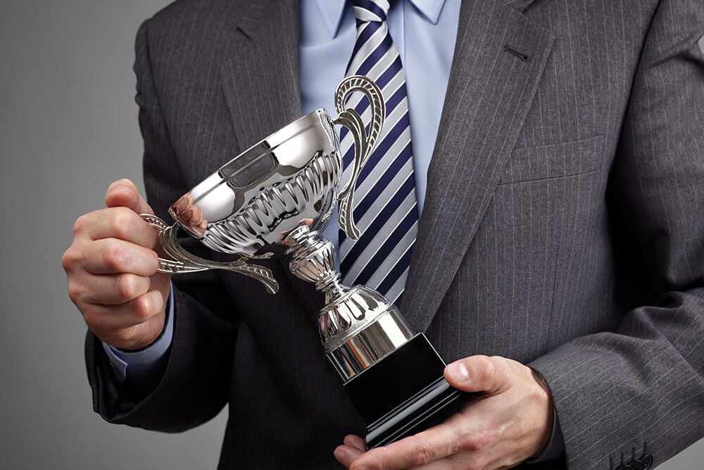 a business man with award